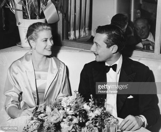 American actress Grace Kelly with fashion designer Oleg Cassini at the Harwyn Club New York City 1955