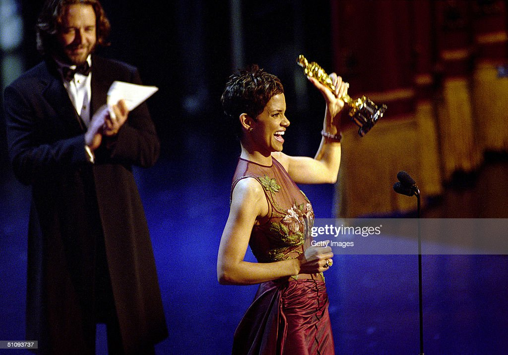 Oscar Winner Halle Berry Winner Accepts The Best Actress Academy Award For Her Performance In The Film 'Monster's Ball,' While Actor Russell Crowe Applauds Her During The 74Th Annual Academy Awards March 24, 2002 At The Kodak Theater In Hollywood, Ca.