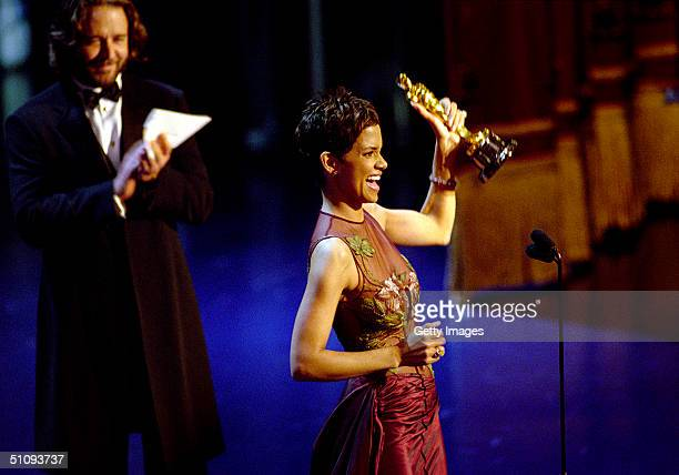 "Oscar Winner Halle Berry Winner Accepts The Best Actress Academy Award For Her Performance In The Film ""Monster's Ball,"" While Actor Russell Crowe..."