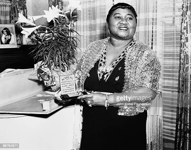 American actress Hattie McDaniel with her Academy Award of Merit for Outstanding Achievement circa 1945 McDaniel won an Oscar for Best Supporting...