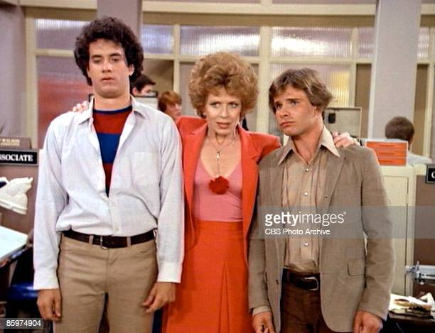 American actress Holland Taylor stands with her arms around actor Tom Hanks and actor Peter Scolari in a scene from the pilot episode of the...
