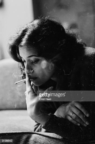 American actress Ina Balin smoking a cigarette