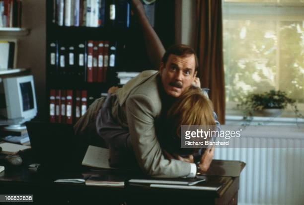 American actress Jamie Lee Curtis stars with English actor and comedian John Cleese in the film 'Fierce Creatures' 1997
