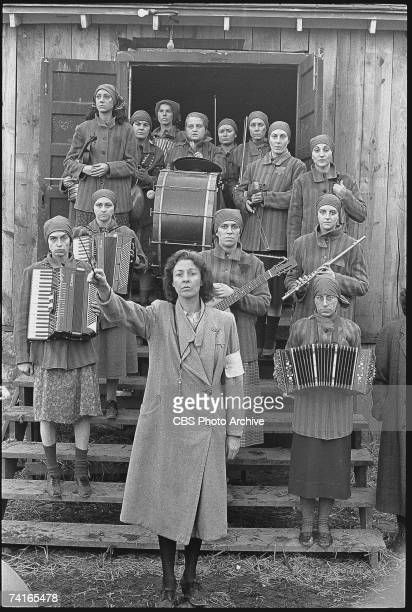 American actress Jane Alexander conducts an orchestra consisting of female Auschwitz prisoners in the madefortelevision movie 'Playing for Time' 1980...