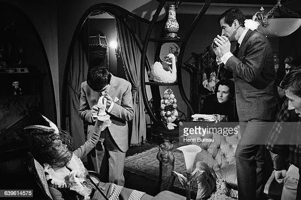 American actress Jane Fonda and French actor Jean-Claude Brialy with director Roger Vadim on the set of his movie La Ronde.