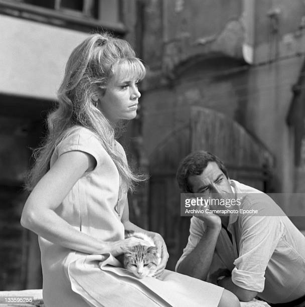 American actress Jane Fonda caressing a cat portrayed with Roger Vadim in the 'Remer' square Venice 1967