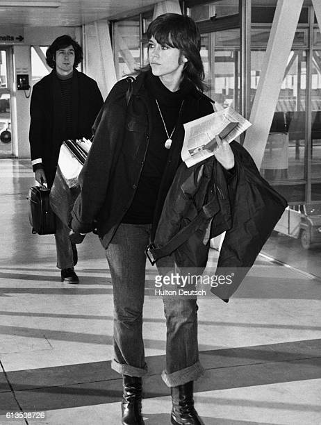 American actress Jane Fonda leaves London airport with her husband Tom Haydon 1973