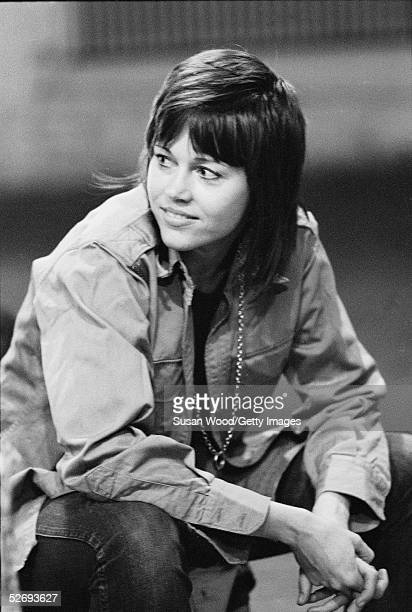 American actress Jane Fonda looks to her right and smiles during a performance of the antiwar road show 'FTA ' New York New York 1971 The title of...