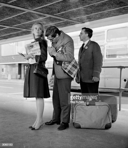 American actress Jane Fonda with her husband French film director Roger Vadim at London Airport 9th October 1965