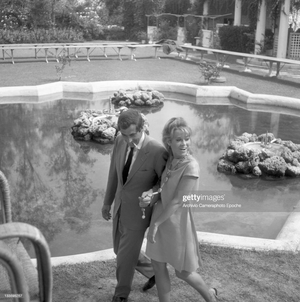 American actress Jane Fonda with Roger Vadim walking in a garden, Lido 1967.