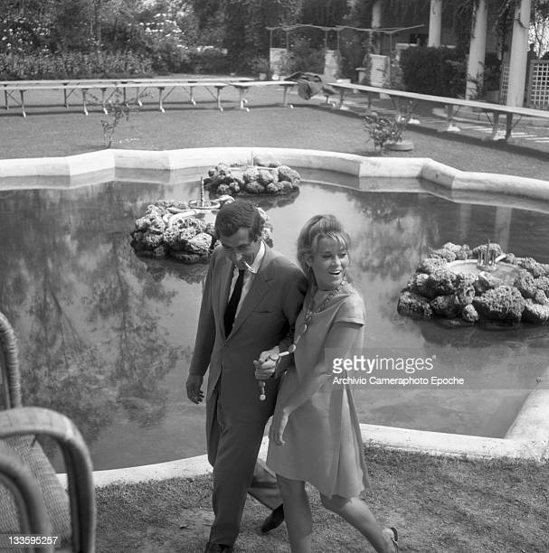 American actress Jane Fonda with Roger Vadim walking in a garden Lido 1967