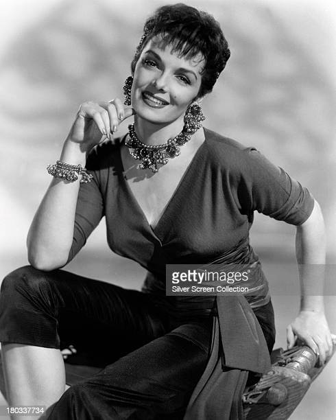 American actress Jane Russell wearing trousers a Vnech top and jewellery circa 1955