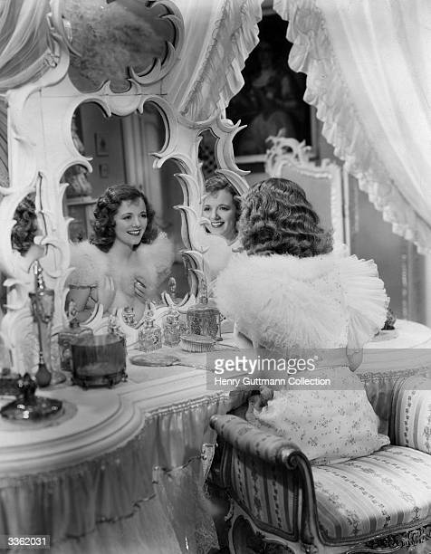American actress Janet Gaynor examines herself in the mirror in a scene from the film 'Adorable' directed by William Dieterle