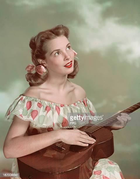 American actress Janet Leigh holding a guitar circa 1950