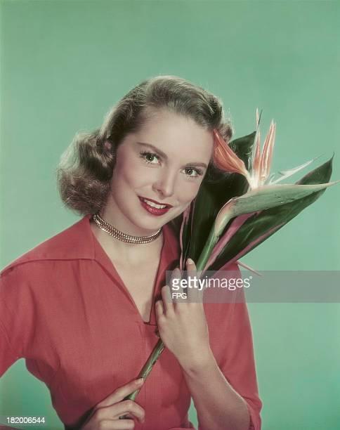 American actress Janet Leigh holding a Strelitzia Reginae or Crane Flower circa 1950