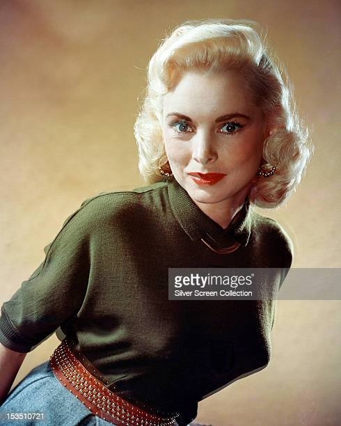 American actress Janet Leigh in a green, short-sleeved top and red belt, circa 1955.