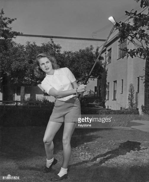 American actress Janet Leigh playing golf circa 1945