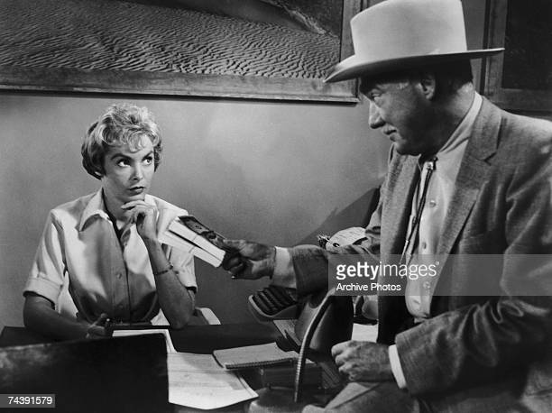 American actress Janet Leigh stars as Marion Crane with Frank Albertson as rich businessman Tom Cassidy in the horror classic 'Psycho', directed by...
