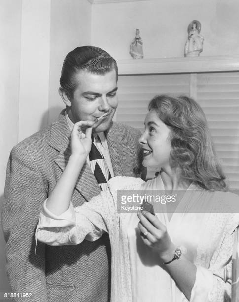 American actress Janet Leigh tests perfume on her husband Stanley Reames, circa 1945.