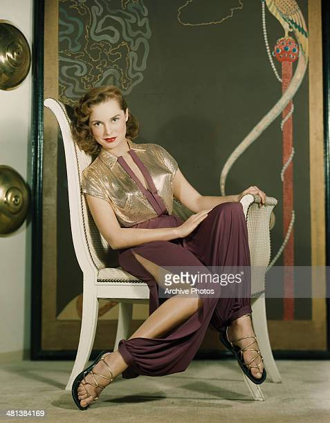 American actress Janet Leigh wearing a gold bolero and splitside harem pants circa 1950