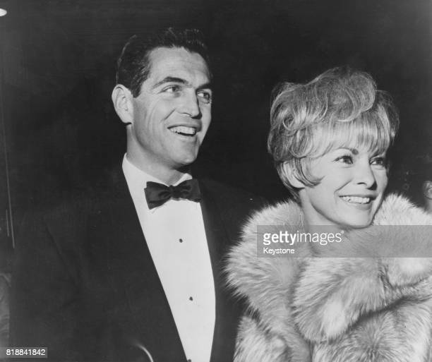 American actress Janet Leigh with her husband Robert Brandt at the Beverly Hills premiere of the film 'Lord Jim' at the Warner Theatre, California,...