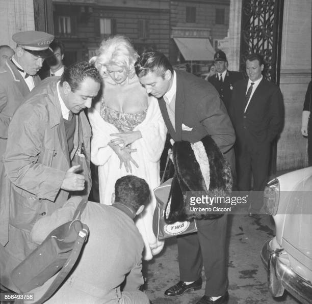 American actress Jayne Mansfield and actor Mickey Hargitay in Via Veneto Rome 1959 Jayne Mansfield dropped something on the floor and someone is...