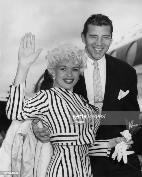 American actress Jayne Mansfield and her husband Mickey Hargitay at London Airport en route to the Cannes Film Festival in France 9th May 1958