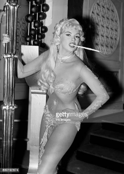American actress Jayne Mansfield as she appears in a nightclub scene from the film Too Hot To Handle being made at MGM's Elstree Studios Herts
