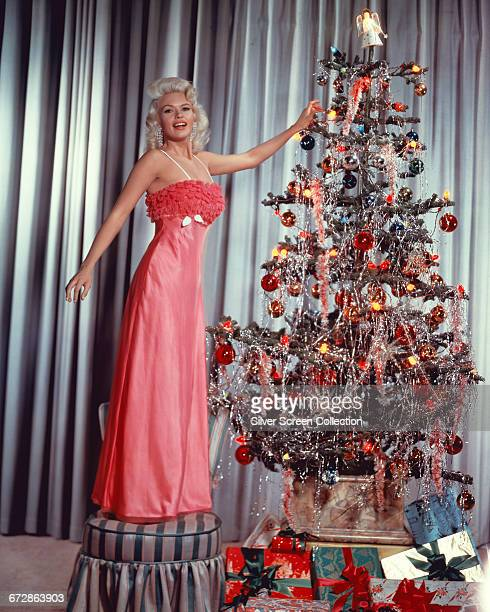 American actress Jayne Mansfield decorates a Christmas tree circa 1960