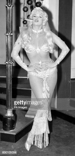 """American actress Jayne Mansfield in costume for a night club scene in the film """"Too Hot To Handle"""" being filmed at MGM's Elstree Studios. * 24/11/98..."""