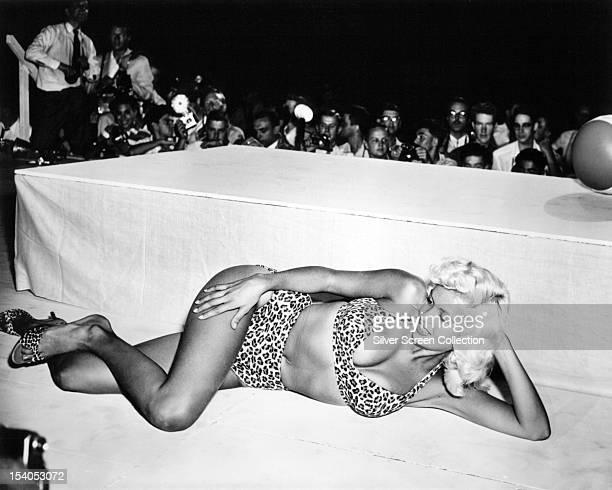 American actress Jayne Mansfield performing in a leopardprint bikini on stage at a nightclub circa 1963