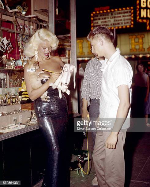 American actress Jayne Mansfield signs autographs for fans while out in Las Vegas USA 1959