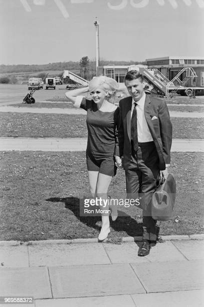American actress Jayne Mansfield with her friend club owner and entrepreneur Alan Wells at Bristol Airport UK 3rd May 1967