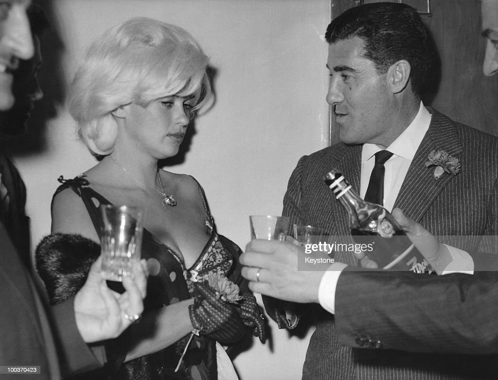 American actress Jayne Mansfield (1933 - 1967) with her husband Mickey Hargitay at a nightclub in Rome, 13th June 1962.