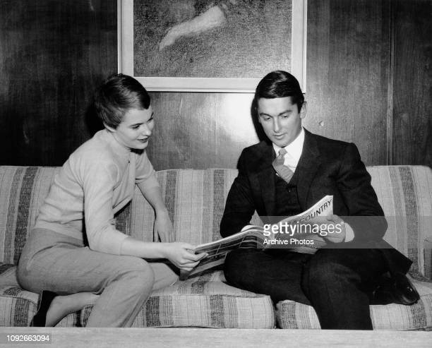 American actress Jean Seberg and Paramount Pictures head Robert Evans reading 'Town and Country' magazine, circa 1967.