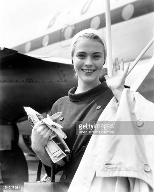 American actress Jean Seberg arriving at London Airport a week before attending the premiere of Otto Preminger's film 'Saint Joan', in which she...