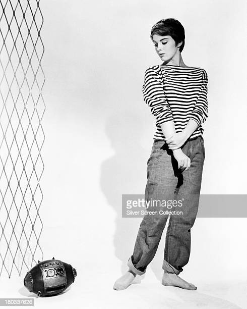 American actress Jean Seberg as Helen Kokintz in a promotional portrait for 'The Mouse That Roared', directed by Jack Arnold, 1959. Beside her is the...
