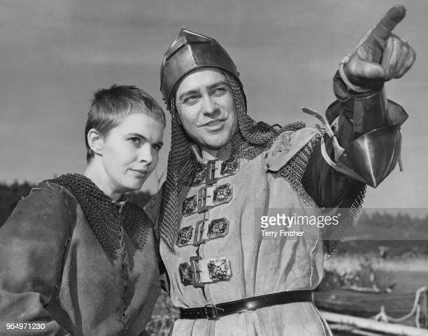 American actress Jean Seberg as Joan of Arc and Richard Todd as Dunois during the filming of George Bernard Shaw's play 'Saint Joan', at Frensham...