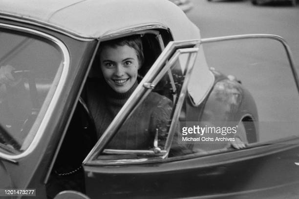 American actress Jean Seberg at the wheel of a sports car in her home town of Marshalltown Iowa March 1957 She has just returned to the USA after...