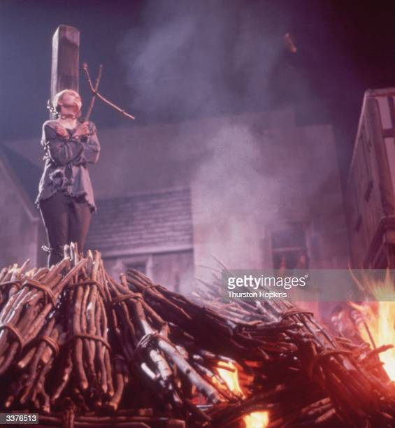 American actress Jean Seberg burning at the stake as Joan of Arc in a scene from the film 'Saint Joan'