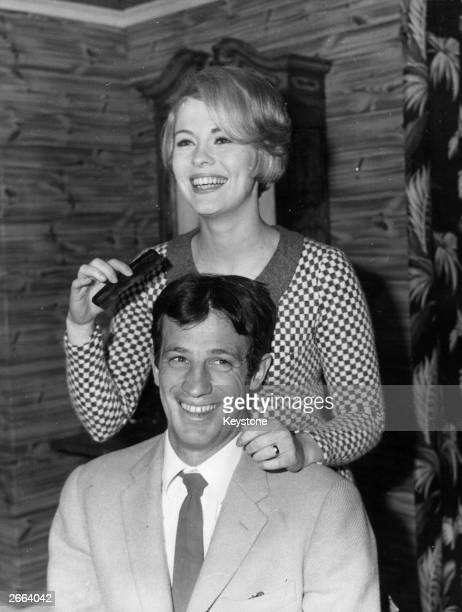 American actress Jean Seberg , combing French actor Jean-Paul Belmondo's hair before they start work on their new film 'Echappement Libre' in studio...