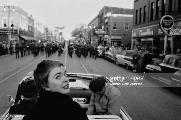 American actress Jean Seberg taking part in a parade celebrating her return to her home town of Marshalltown, Iowa, 26th March 1957. Seberg has just...