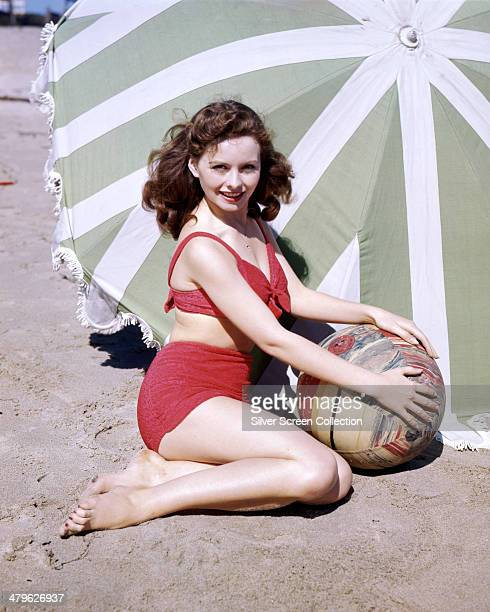 American actress Jeanne Crain wearing a bikini at the beach circa 1945
