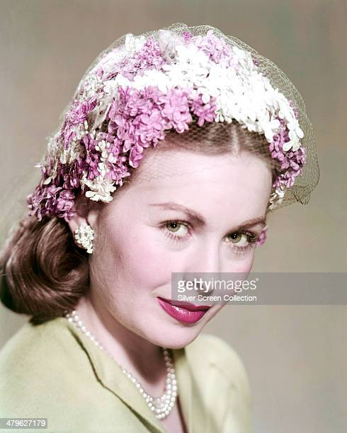 American actress Jeanne Crain wearing a floral headdress circa 1955