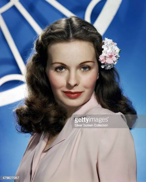 American actress Jeanne Crain wearing a flower in her hair circa 1950