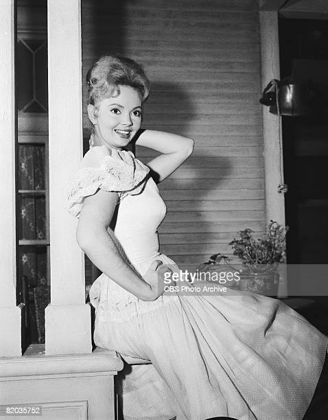 American actress Jeannine Riley as Billie Jo Bradley poses on the porch of the 'Petticoat Junction' set entitled 'Kate's Recipe for Hot Rhubarb' Los...