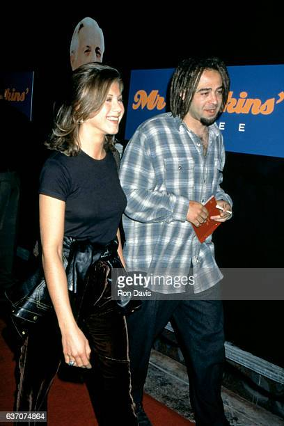 American actress Jennifer Aniston and American musician Adam Duritz attend the 'Mr Jenkins Soiree' at the Ace Gallery Los Angeles on September 29...