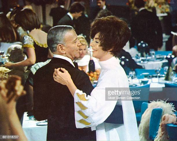 American actress Jennifer Jones as Lisolette Mueller being wooed by Fred Astaire as conman Harlee Claiborne in the disaster film 'The Towering...