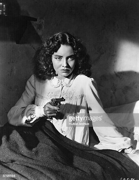 American actress Jennifer Jones the screen name of Phyllis Isley defends her bed and her honour in a scene from 'Duel In The Sun' The film was...