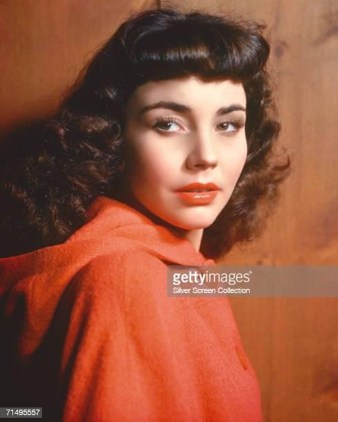 American actress Jennifer Jones wearing a red cape circa 1945